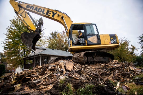 The Bradley company crane sits on top of a demolished home, 103 Panola street after it was teared down, Thursday, November 7, 2019 at Jackson, Tenn. The blight elimination program is funded by the Tennessee Housing Development Agency and run by Jackson's Community Redevelopment Agency.