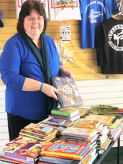 Donna Martin prepares a book donation for a Moreland Heights substitute teacher who is starting a mobile library for children in the outlying rural areas. Nov. 6, 2019.