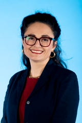 Knox.biz 40 Under 40 nominee Claudia Caballero, Executive Director at Centro Hispano, poses for a photo in the Knox News photo studio in Knoxville, Tenn. on Wednesday, Nov. 6, 2019.