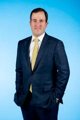Knox.biz 40 Under 40 nominee Christian Corts, President of BB&T - Tennessee Region, poses for a photo in the Knox News photo studio in Knoxville, Tenn. on Tuesday, Nov. 5, 2019.