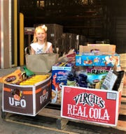 Holding food drives for Second Harvest Food Bank since 2013, Leilani Johns delivered a pallet of donations in 2017.