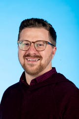 Knox.biz 40 Under 40 nominee Joshua Peterson, Founding Artistic Director at River & Rail Theater Company, poses for a photo in the Knox News photo studio in Knoxville, Tenn. on Wednesday, Nov. 6, 2019.