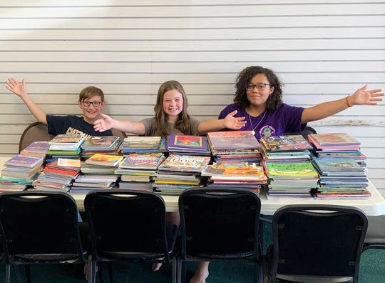 South Knoxville Taekwondo students Billy Bain, Olivia Wester and Aubrey Pittman assisted with a book drive to start a mobile library for rural children. Oct. 13, 2019.