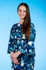 Knox.biz 40 Under 40 nominee Erin Burr, Section Manager of Assessment & Evaluation at ORAU, poses for a photo in the Knox News photo studio in Knoxville, Tenn. on Tuesday, Nov. 5, 2019.