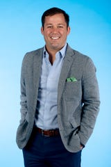 Knox.biz 40 Under 40 nominee Jason Emert, Founder and Managing Director of The Emert Group, poses for a photo in the Knox News photo studio in Knoxville, Tenn. on Tuesday, Nov. 5, 2019.
