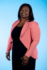 Knox.biz 40 Under 40 nominee Denetria Moore, Founder and Executive Director of Girl Talk, Inc., poses for a photo in the Knox News photo studio in Knoxville, Tenn. on Tuesday, Nov. 5, 2019.