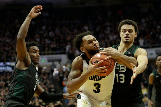Purdue guard Jahaad Proctor (3) is blocked by Green Bay guard Trevian Bell (13) and Green Bay guard PJ Pipes (2) as he drives to the net during the first half of a NCAA Men's basketball game, Wednesday, Nov. 6, 2019 at Mackey Arena in West Lafayette.