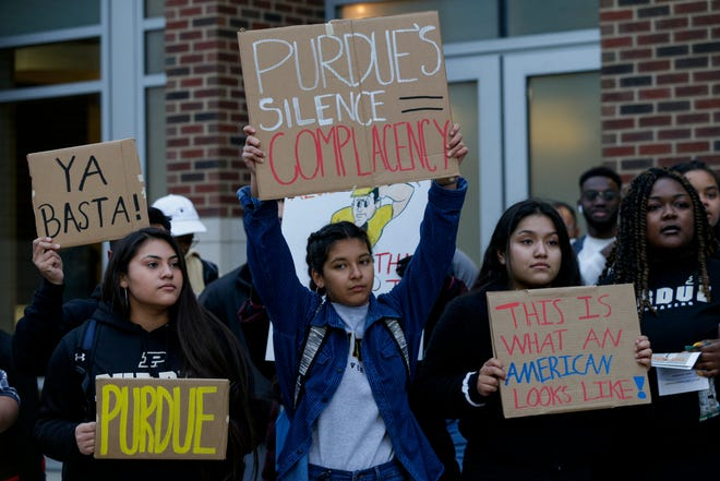 A group of students gather outside Mackey Arena to protest CVS after a Purdue student said he was told he couldn't buy cold medicine because the store demanded he back up his Puerto Rican driver's license with immigration paperwork., Wednesday, Nov. 6, 2019 in West Lafayette.