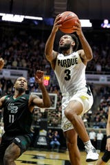 Purdue guard Jahaad Proctor (3) shoots over Green Bay guard JayQuan McCloud (11) during the second half of an NCAA college basketball game in West Lafayette, Ind., Wednesday, Nov. 6, 2019. (AP Photo/Michael Conroy)