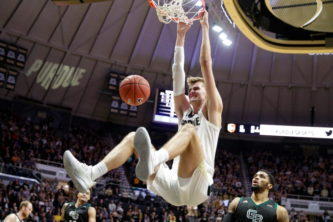 Purdue center Matt Haarms (32) gets a basket on a dunk in front of Green Bay forward Manny Patterson (15) during the second half of an NCAA college basketball game in West Lafayette, Ind., Wednesday, Nov. 6, 2019. (AP Photo/Michael Conroy)
