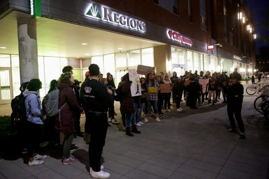 A group of students gather outside the Northwestern Avenue CVS a in response to a Purdue student saying he was told he couldn't buy cold medicine because the store demanded he back up his Puerto Rican driver's license with immigration paperwork., Wednesday, Nov. 6, 2019 in West Lafayette.