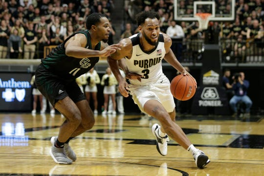 Purdue guard Jahaad Proctor (3) drives to the net against Green Bay guard JayQuan McCloud (11) during the second half of a NCAA Men's basketball game, Wednesday, Nov. 6, 2019 at Mackey Arena in West Lafayette.