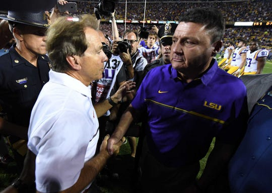 Alabama  head coach Nick Saban, left, greets LSU head coach Ed Orgeron following the Crimson Tide's 10-0 win at Tiger Stadium on Nov. 5, 2016.