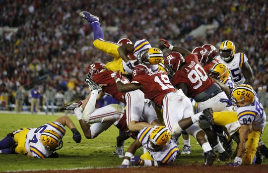 LSU running back Leonard Fournette (7) tries to reach the end zone as the Alabama defense holds at the line during a Nov. 7, 2015, game.