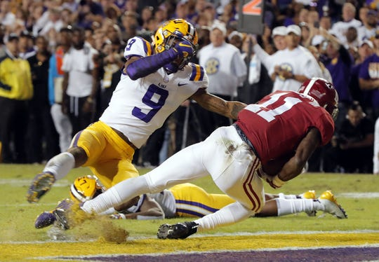 Alabama wide receiver Henry Ruggs III (11) scores on a touchdown reception against LSU safety Grant Delpit (9) on Nov. 3, 2018.