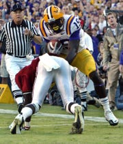 LSU's Deangelo Peterson runs the ball back 23 yards to set up an LSU fourth-quarter touchdown against Alabama Saturday afternoon in Tiger Stadium in Baton Rouge. LSU won 24-21.