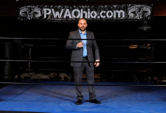 Chris Cruit stands in the ring at the Premiere Wrestling Alliance  of Ohio's training room in Lancaster.