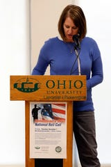 Janice Smeltzer, a staff member at Ohio University Lancaster, reads names of military members from Ohio who died while serving. Smeltzer and others read from a list of more than 3,000 names during a Remembrance Day ceremony at school's campus in Lancaster.