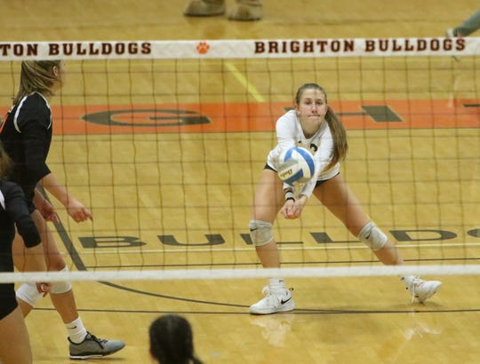 Evelynn Lemons of Brighton handles a serve from South Lyon in a district semifinal volleyball match on Wednesday, Nov. 6, 2019.