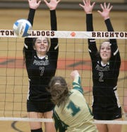 Abby Mondro (7) and Kylie Ray (2) of Pinckney attempt to block a shot by Howell's Ella Januszewski in a district semifinal volleyball match on Wednesday, Nov. 6, 2019.