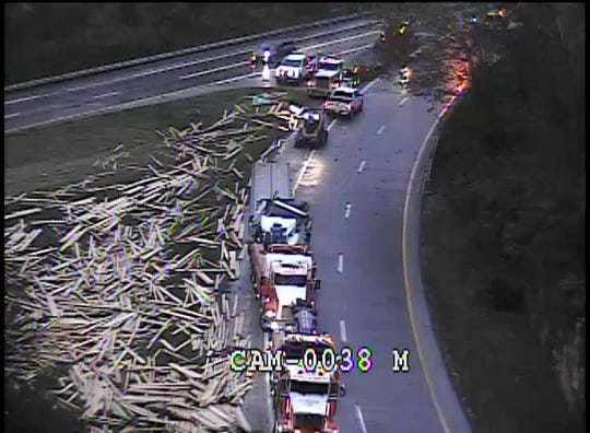 All northbound lanes of Interstate 71 at the Watterson Expressway / I-264 in Louisville are shut down Thursday morning, Nov. 7, 2019, after a semitruck carrying lumber rolled over, according to MetroSafe.