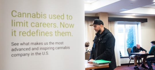 Marlon Lewis of Lansing, 32, interviews for a job in the cannabis industry Thursday morning, Nov. 7, 2019, during the Green Peak Innovations job fair at Hyatt Place Lansing in the Eastwood Towne Center.  The company is looking to fill about 50 jobs.