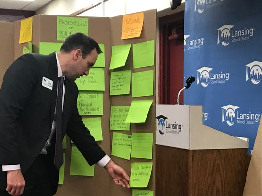 Greg Sieszputowski of the Michigan Association of School Boards looks at feedback provided during a community input session on Nov. 6, 2019. The meeting was designed to collect feedback during Lansing School District's ongoing superintendent search.