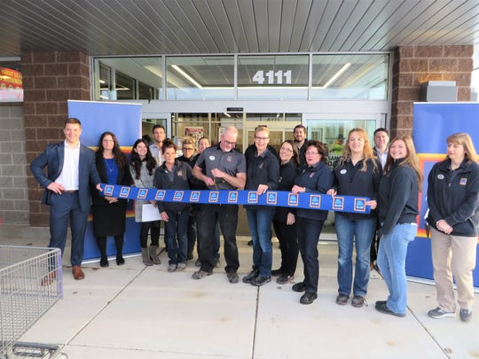 Workers cut the ribbon on the newly remodeled and expanded ALDI grocery store at 4111 Harbor Town Lane in Manitowoc on Nov. 1, 2019.