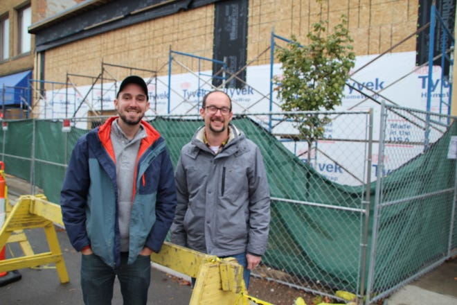 Entrepreneurs Alex Sheridan, left, and Luke Henry are working on various projects along South Main Street in downtown Marion. They're shown in front of The Brickyard on Main, a large event venue that already has seven weddings and two proms booked for 2020. The pair has invested about $2 million into purchasing and renovating property along South Main Street.