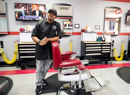 Owner Jarvis Becton at his station inside A Closer Look Barbershop in Collierville, Tenn., on Thursday Oct. 31, 2019.