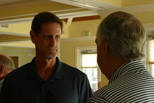 Marco Island City Manager Mike McNees speaks with a resident during the Marco Island Police Foundation's Lunch with the Chief at Island Country Club on Nov. 7, 2019.