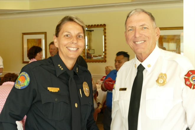 Chief Tracy L. Frazzano of the Marco Island Police Department smiles to the camera during Marco Island Police Foundation's Lunch with the Chief in Island Country Club on Nov. 7. Likewise, chief Michael D. Murphy of the Fire-Rescue Department stands next to her.