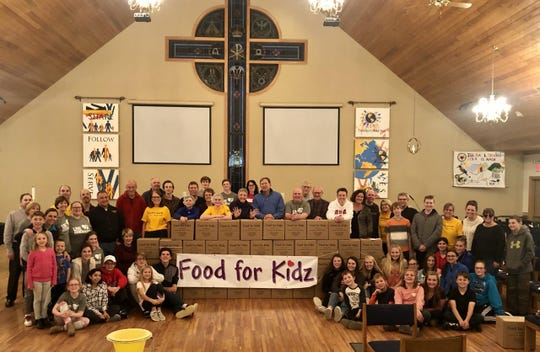 Members of Church of the Resurrection in Pewaukee packed over 50,000 meals for people struck by crisis in different countries.