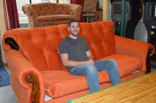 """City Lounge in Cudahy is putting on a """"Friends""""-inspired pop-up bar experience Nov. 8-30.Alex Ahmad, owner of City Lounge, is sitting inside a cafe modeled after Central Perk."""