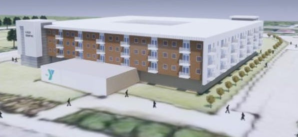 The former Fletcher Elementary School would have three floors added to create 100 apartments under a new plan.
