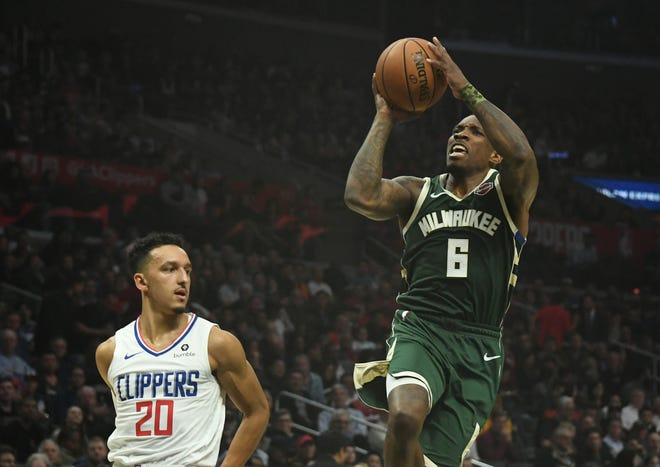 Bucks guard Eric Bledsoe puts up a running shot against Clippers guard Landry Shamet in the third quarter.