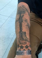 Erik Smith got a tattoo of a fallen service member cross and seven stars in honor of the seven Marines killed from his unit, Milwaukee-based Fox Company, Marine Reserves 2nd Battalion, 24th Marine Regiment, during two deployments in Iraq.