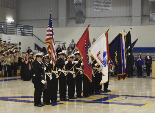 The Mountain Home High School Color Guard lowers every flag but Old Glory during the national anthem Thursday at the Freedom is Not Free veterans program at Mountain Home High School.