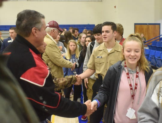 Mountain Home High School students shake hands with area veterans after Thursday's Freedom is Not Free veterans program. Roughly 1,500 high school students from grades 8-12 attended the event.