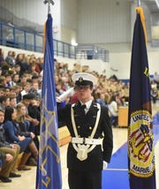 A Mountain Home High School Navy Junior ROTC cadet salutes the Mountain Home High School flag during the posting of the colors at Thursday's Freedom is Not Free program.