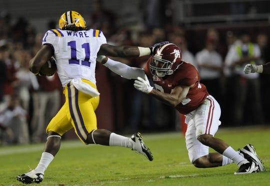 Alabama defensive back DeQuan Menzie (24) stops LSU running back Spencer Ware (11) during the first half of play at Bryant-Deny Stadium Saturday, Nov. 5, 2011, in Tuscaloosa, Ala. (Montgomery Advertiser, Mickey Welsh )