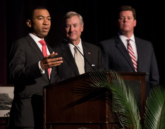 Mayor-elect Steven Reed speaks as Mayor Todd Strange watches on during the Montgomery Area Committee of the Arts business award ceremony at Renaissance Hotel in Montgomery, Ala., on Thursday, Nov. 7, 2019.
