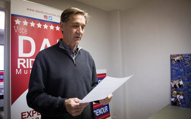 Republican mayor-elect Dan Ridenour reads off a prepared statement during a press conference at his transition headquarters on Thursday. Ridenour was asking for a halt to new city hiring and spending until the administration transition in January.