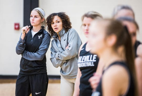 Daleville coach Ashley Fouch (left) instructs her girls basketball players during practice Wednesday, Nov. 7, 2019.