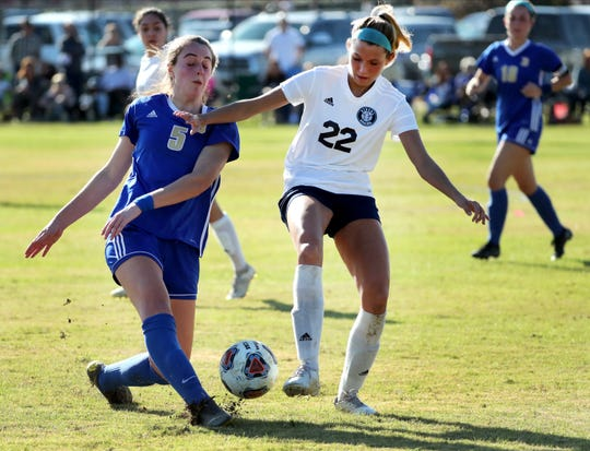 Brentwood's Kate Boring (5) \kicks the ball as Siegel's Emily Baker (22) tries to steal it in the quarterfinals of the Girls Class AAA Soccer Tournament, on Wednesday, Nov. 6, 2019, in Murfreesboro.