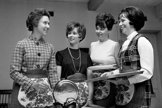 Waitresses Mrs. Tom Schlater, left, Mrs. Tommy Pulliam, Mrs. Jack Youree and Mrs. J.L. Thompson take a practice run Nov. 25, 1969, for the upcoming annual Waffle Shop at the Downtown Presbyterian Church.