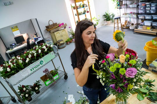 Jessica Gnagey builds a bouquet of flowers at Ruth Messmer Florist.