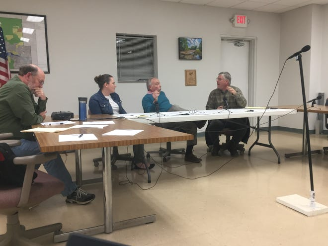 Granville Township Trustees debate the issue of mutual aid to Union Township on Nov. 6. From left, Fiscal Officer Jerry Miller, and trustees Bryn Bird, Kevin Bennett and Dan VanNess.