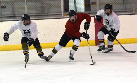 Newark Generals' Tyler Dickerson (center) dodges between teammates Miles Eckenrode (left) and Duncan Humphries during a practice on Wednesday, Nov. 6, 2019 at Lou & Gib Reese Ice Arena. The Generals will opened their season on October 31.