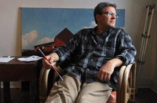James Young sits in his painting studio, above the Kussmaul Gallery in Granville, Ohio.